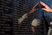 Vietnam Veterans Memorial Posters - Hand Touches And Is Reflected Poster by Todd Gipstein