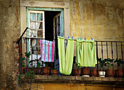 Balcony Framed Prints - Hanged Clothes Framed Print by Carlos Caetano