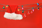 Wish Prints - Hanging lights with santa hat Print by Sandra Cunningham