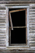 Broken Window Framed Prints - Hanging Loose Framed Print by Bob Christopher
