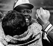 Baseball Player Framed Prints - Hank Aaron Is Hugged By His Mother Framed Print by Everett