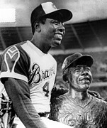 Baseball Player Framed Prints - Hank Aaron Poses With Bust Of Himself Framed Print by Everett