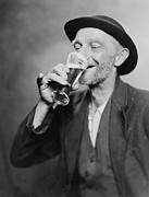 Glass Prints - Happy Old Man Drinking Glass Of Beer Print by Everett