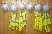 Building Feature Framed Prints - Hard Hats And Safety Vests Framed Print by Corepics