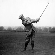 Famous Golfers Framed Prints - Harry Vardon swinging his golf club Framed Print by International  Images