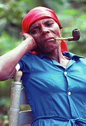 Haitian Photos - Hatian woman with a red scarf and a pipe by Johnny Sandaire