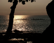 Canoe Originals - Hawaiian dugout canoe race at sunset by Michael Bessler
