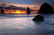 Haystack Rock Framed Prints - Haystack Sunset Framed Print by Mike  Dawson