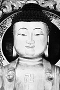 Sha Posters - Head Face And Shoulders Of Large Golden Buddha Statue Showing Buddhist Swastika Symbol Poster by Joe Fox