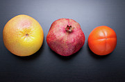 Grapefruit Posters - Healthy Fruits On Dark Wooden Background Poster by daitoZen