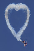 Flying Photos - Heart shape smoke and plane by Garry Gay