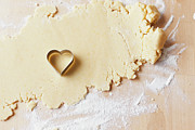 Cookie Prints - Heart Shaped Cookie Cutter On Dough Print by Cultura/Nils Hendrik Mueller