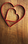 Wood Cutters Prints - Heart shaped cookie cutters Print by Marlene Ford