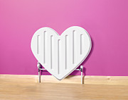 Home Ownership Posters - Heart Shaped Radiator Poster by Peter Dazeley