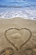 High Vulnerability Prints - Heartshape drawn in sand on beach Print by Sami Sarkis