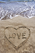 No Love Posters - Heartshape drawn in sand on beach with Love word inside Poster by Sami Sarkis