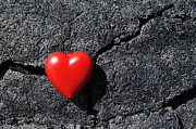 Out Of Context Prints - Heartshape on cold black lava Print by Sami Sarkis