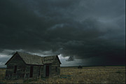 Abandoned Houses Framed Prints - Heavy Dark Clouds Foretell A Possible Framed Print by Carsten Peter