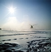 Powder Snow Posters - Helicopter Landing On Snow Poster by Ria Novosti