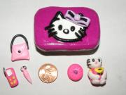 Kitty Sculptures - Hello Kitty Tin and Accessories by Megan Brandl
