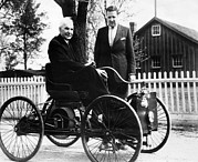 Henry Framed Prints - Henry Ford Sits In His First Ford Car Framed Print by Everett