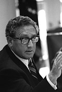 Gestures Photo Posters - Henry Kissinger In A Meeting Following Poster by Everett
