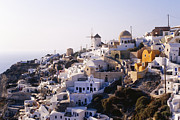 Apartment Framed Prints - Hillside Town of Oia Framed Print by Jeremy Woodhouse