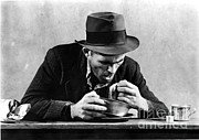 Bread Line Prints - Homeless Man Eating In A Soup Kitchen Print by Photo Researchers