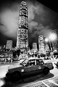 Rank Framed Prints - Hong Kong Red Taxi At Taxi Rank At Night In Front Of International Finance Centre 2 On Hong Kong Framed Print by Joe Fox