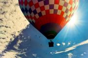 Sun Rays Photo Prints - Hot Air Balloon Eclipsing the Sun Print by Bob Orsillo