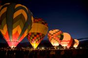 Crowds  Prints - Hot Air Balloons Filling At Dawn Print by Ralph Lee Hopkins