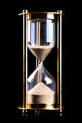 Hourglass Framed Prints - Hourglass sand timer on black Framed Print by Richard Thomas