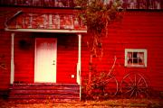 Wagon Wheel Photos - House of the Wagon Wheels by Emily Stauring