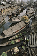 Poor People Photo Prints - Houseboats Line A Waterway Print by Gordon Wiltsie