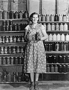 Canning Jars Posters - Housewife Proudly Displays Her Home Poster by Everett