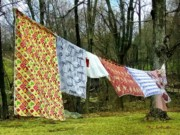 Colorful Quilts Posters - How to Dry an American Quilt Poster by RC DeWinter
