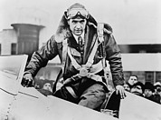 Aeronautics Prints - Howard Hughes Emerging From An Airplane Print by Everett
