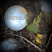 Hubcaps And Oil Cans Print by Steve McKinzie