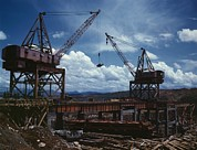 Large Scale Photo Prints - Huge Cranes Lift Steel Beams Print by Everett