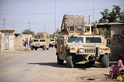 Hmmwv Posters - Humvees Conduct Security Poster by Stocktrek Images