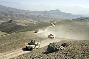 Dirt Roads Photos - Humvees Traverse Rugged Mountain Roads by Stocktrek Images
