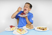 Humour Prints - Hungry boy eating lot of cake Print by Matthias Hauser