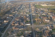 Floods Photos - Hurricane Katrina Devastated This St by Everett