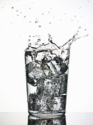 Water Color Framed Prints - Ice Cubes Splashing Into Fizzy Drink Framed Print by Walter Zerla
