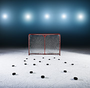 Puck Posters - Ice Hockey Goal Surrounded By Pucks Poster by Robert Decelis Ltd