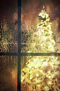 Mysterious Art - Icy window with holiday tree full of lights by Sandra Cunningham