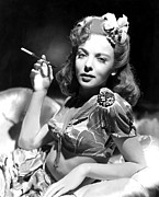 Cushion Metal Prints - Ida Lupino, Portrait Of Her Smoking Metal Print by Everett