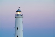 Locations Prints - Illuminated lighthouse at sunset Print by Sami Sarkis