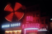 Sami Sarkis Prints - Illuminated neon signs of the Moulin Rouge Print by Sami Sarkis