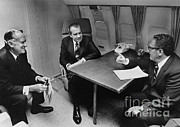 Kissinger Prints - In Flight Discussion, President Nixon & Print by Photo Researchers
